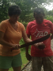 """This is Simone. He is a native Gnobe. He works for Bobby and Shirlene. He is trying to teach me to open a coconut with a machete! He says, """"You can't fear the machete."""" (Trust me, I feared the machete!!)"""